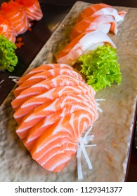 Fresh Salmon sashimi sliced and a piece of Salmon sushi in the Japanese restaurant.