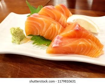 Fresh salmon sashimi with wasabi