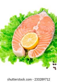 Fresh salmon steak on lettuce. Whole background.
