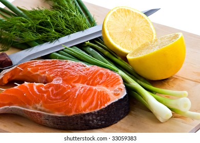 fresh salmon steak with spring onions on board