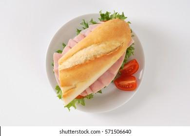 fresh sandwich with ham on white plate