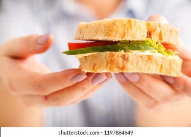 Fresh sandwich in hand