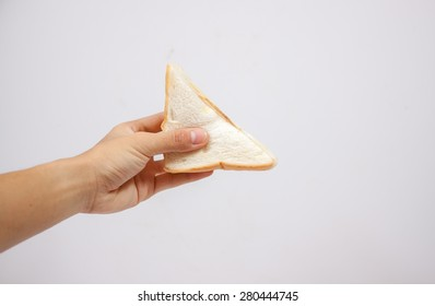Fresh sandwich in hand. Isolated on a white background.