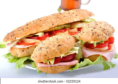 Fresh sandwiches with ham and cheese and tea
