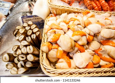 Fresh scallopw and razor shells at the market stall in Toulouse, France.