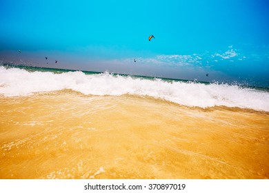 Fresh Sea Ocean Waves washing yellow sand beach.