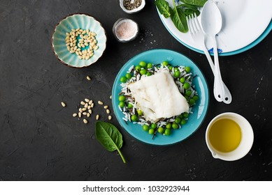 Fresh sea white cod fish with a garnish of wild rice and basmati with young green peas. top view. Flatlay