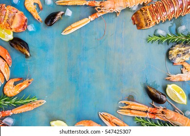 Fresh seafood flat lay frame with copy space on blue background