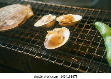 Fresh seafood, hard shell clam. cooking. grill on the cast-iron grill over the red hot coals