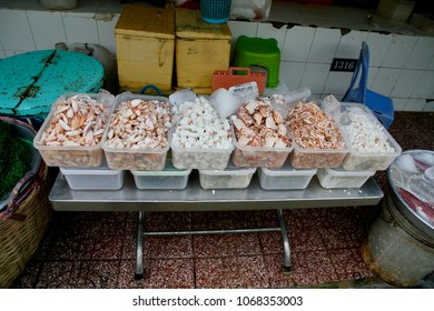 Fresh seafood meat from crabs to prawns on display in a produce market in Vietnam.