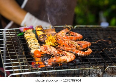 Fresh seafood on grill in the exotic market in Thailand