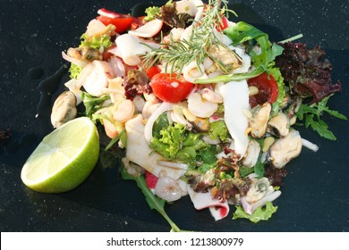 Fresh seafood salad with extra virgin olive oil