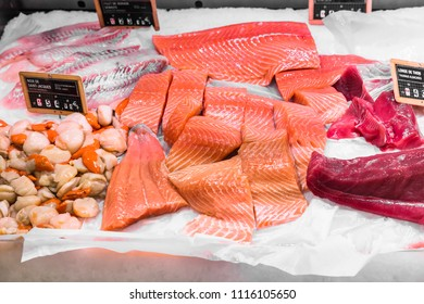 Fresh seafood: scallops, salmon and tuna fillet  on display in a French supermarket. Paris, France