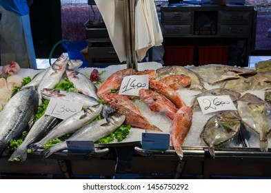 Fresh seafood (sea bass, redfish) on a fish market stand in Italy, Venice