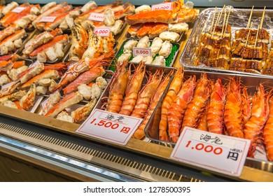 Fresh seafood selling at Kuromon Ichiba in Osaka Japan. The Kuromon Ichiba is a spacious market with vendors selling street food, fresh produce and shellfish, plus souvenirs.