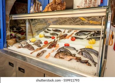 Fresh seafood served at Greek restaurant in Rethymno city on Crete island. Europe. - Shutterstock ID 559911793