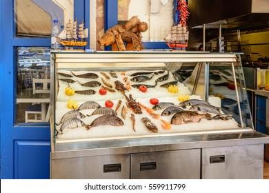 Fresh seafood served at Greek restaurant in Rethymno city on Crete island. Europe. - Shutterstock ID 559911799