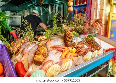 Fresh seafood served at Greek restaurant in Rethymno city on Crete island. Europe. - Shutterstock ID 559911805