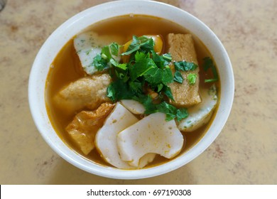 Fresh Seafood Tomato soup with rice noodle, Asian cuisine. Kota Kinabalu Famous fish soup for breakfast.
