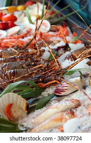 Fresh seafoods lay on an ice