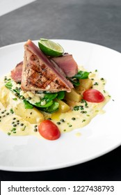 fresh seared tuna steak with creamy mustard and kampot pepper sauce