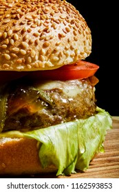 Fresh served burger ready to be eaten. Enjoy in closeup view.