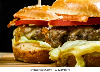 Fresh served burgers ready to be eaten. Enjoy in closeup view.