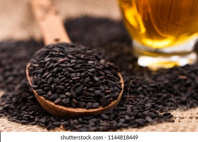 fresh sesame seeds on a rustic background