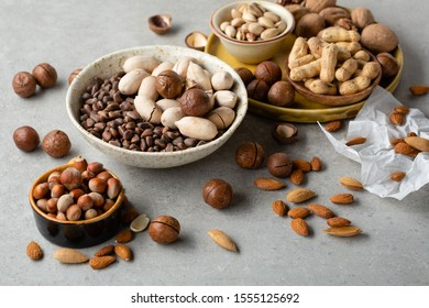 Fresh set of different nuts in bowls