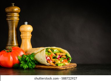 Fresh Shawarma Sandwich with Red Tomato, Salt and Pepper Grinder with Copy Space
