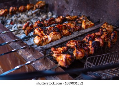 Fresh shish kebab on skewers is fried on the grill. Grilled meat on skewers. Cooking.