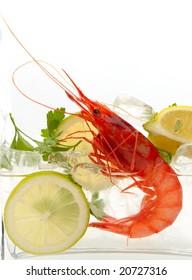 fresh shrimp with lemon on ice