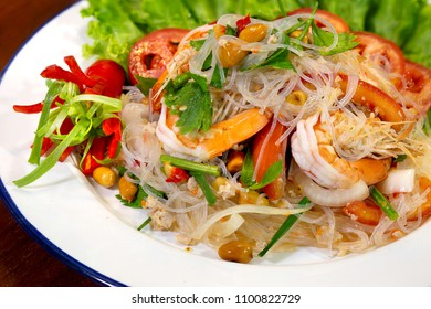 Fresh shrimp spicy salad with vermicelli, thai food delicious in white dish / Blurred and Select focus