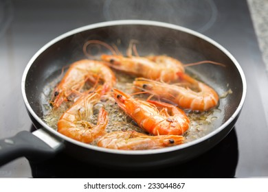 Fresh shrimps being fried in olive oil - very shallow DOF