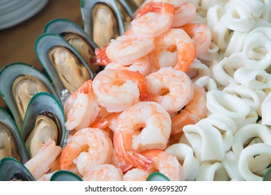 Fresh shrimps and seafood on ice buffet line at restaurant in the hotel