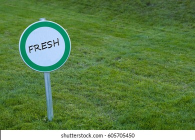Fresh. Sign on the grass