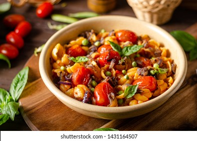 Fresh and simple food, homemade pasta with balsamico tomatoes and herbs