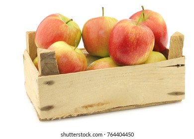 "fresh ""Sissi red"" apples in a wooden crate on a white background"