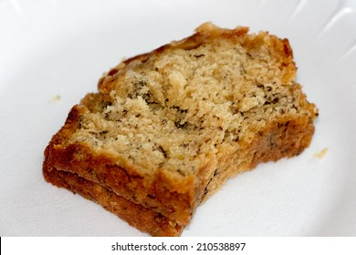 fresh slice of banana bread isolated on white plate