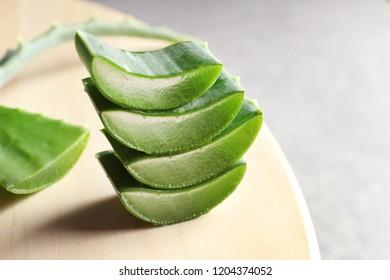 Fresh sliced aloe vera leaves on light table