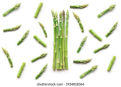 Fresh sliced asparagus plant on white background. Top view. Vegan healthy food.