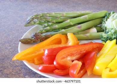 Fresh sliced bell peppers and asparagus. Home cooking, clean eating and homemade healthy Paleo meals concept.