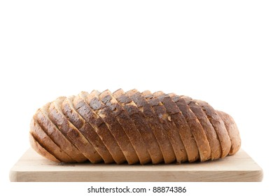 Fresh sliced bread on wood, ready to eat