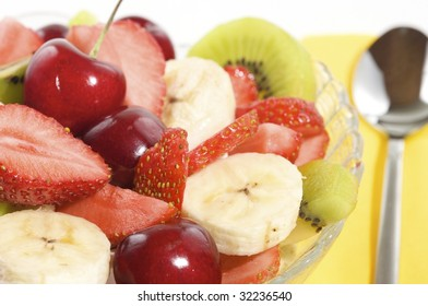 fresh, sliced fruit salad with spoon