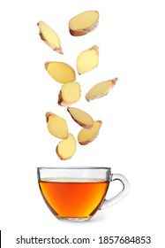 Fresh sliced ginger falling into glass cup of tea on white background