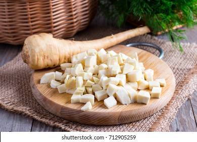 Fresh sliced parsnips on a wooden board