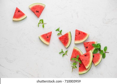 Fresh sliced watermelon on marble table in summertime