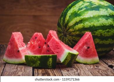 Fresh sliced watermelon on the wooden table. Sweet healhty dessert