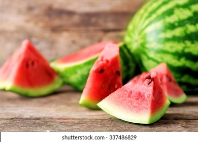 Fresh sliced watermelon wooden background