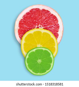 Fresh slices of grapefruit, lemon and lime on a blue background. Healthy habits concept. Flat lay, top view - image
